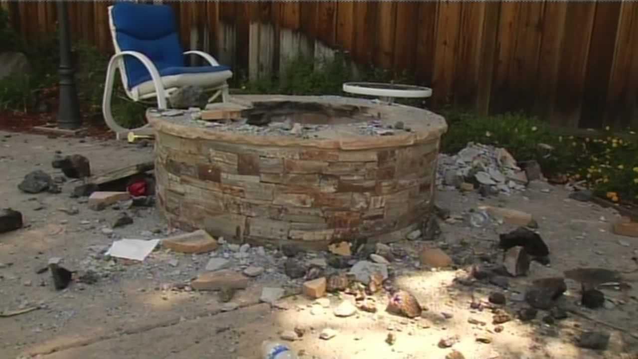 Two girls suffered minor injuries when a built-in barbecue pit exploded in the backyard of a Campbell home on Wednesday night, a Santa Clara County fire battalion chief said.