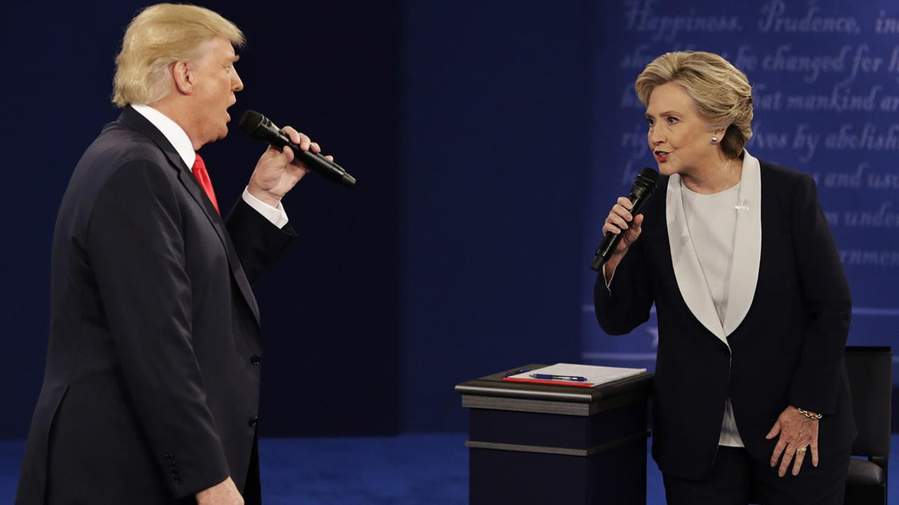 Donald Trump and Hillary Clinton speak during the second presidential debate at Washington University in St. Louis, Sunday, Oct. 9, 2016. (AP Photo/John Locher)