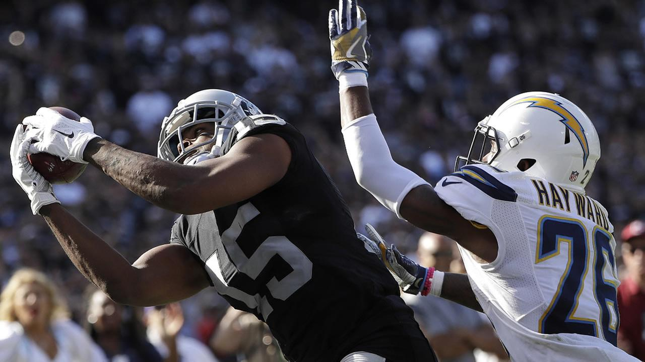 Raiders Michael Crabtree catches a touchdown pass in front of Chargers Casey Hayward during a game in Oakland, Calif., on Sunday, Oct. 9, 2016. (AP Photo/Marcio Jose Sanchez)