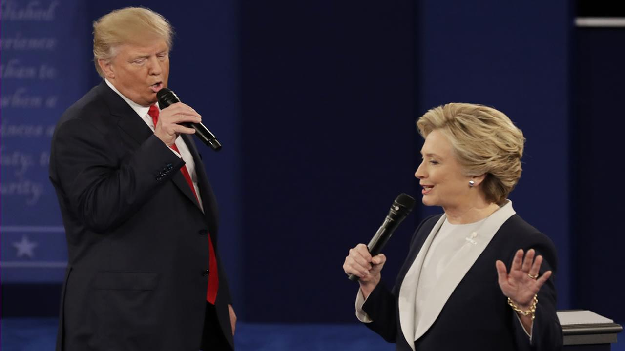 Donald Trump and Hillary Clinton speak during the second presidential debate at Washington University in St. Louis, Sunday, Oct. 9, 2016.