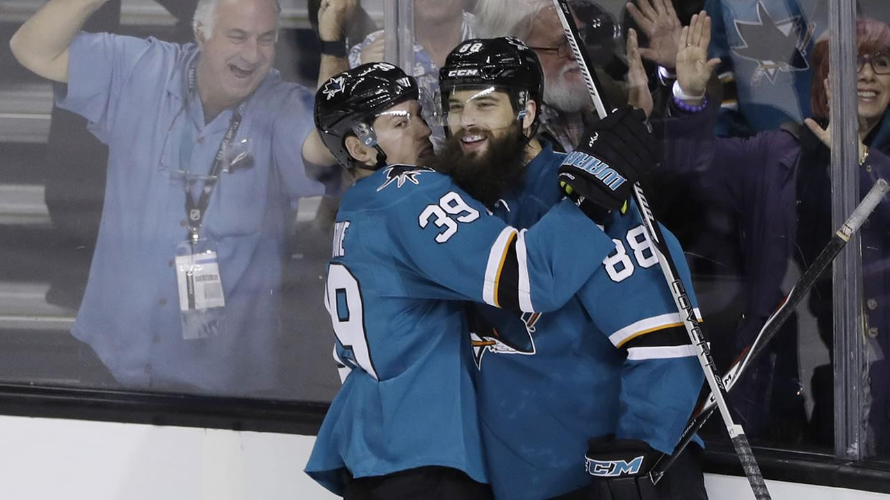 San Jose Sharks defenseman Brent Burns (88) celebrates his goal with teammate Logan Couture during a game against Los Angeles Kings Oct. 12, 2016, in San Jose, Calif. (AP Photo)