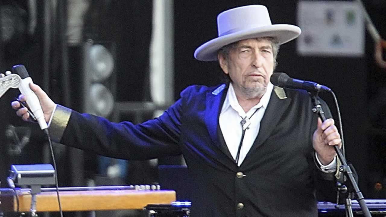 This July 22, 2012, file photo shows U.S. singer-songwriter Bob Dylan performing onstage at Les Vieilles Charrues Festival in Carhaix, western France.
