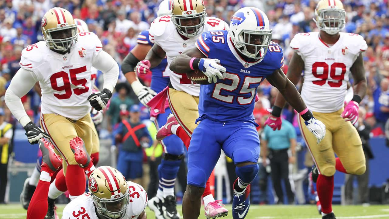 Bills running back LeSean McCoy beats San Francisco 49ers defenders for a touchdown during a game on Sunday, Oct. 16, 2016, in Orchard Park, N.Y. (AP Photo/Bill Wippert)