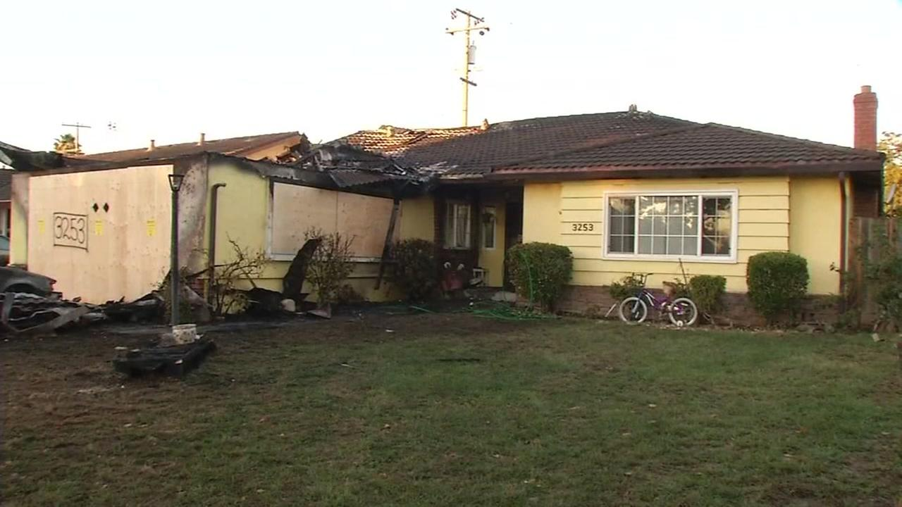 Investigators are working to determine the cause of a massive fire at a home in San Jose, Calif. on Tuesday, Oct. 18, 2016.