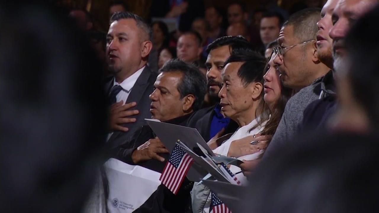 This image shows people being sworn in as new citizens in Oakland, Calif. on Oct. 19, 2016.