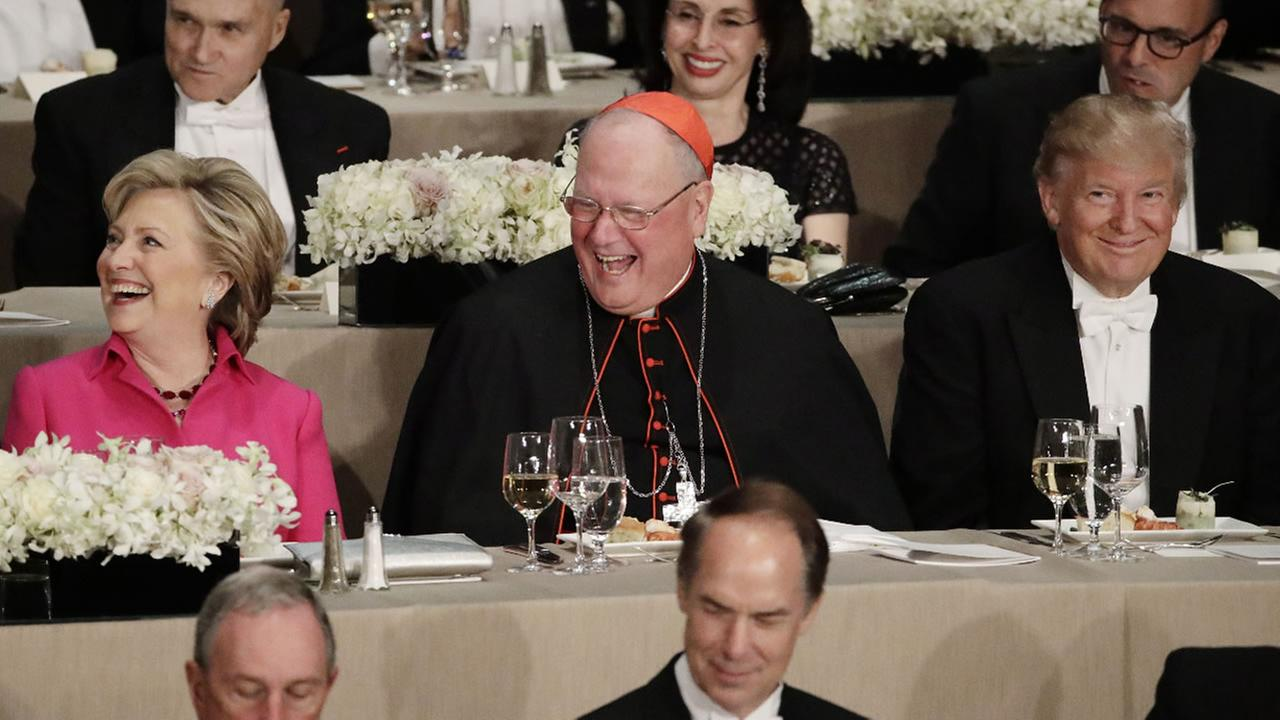 Cardinal Timothy Dolan, Hillary Clinton, and candidate Donald Trump sit at the 71st Annual Alfred E. Smith Memorial Foundation Dinner Thursday, Oct. 20, 2016, in New York.