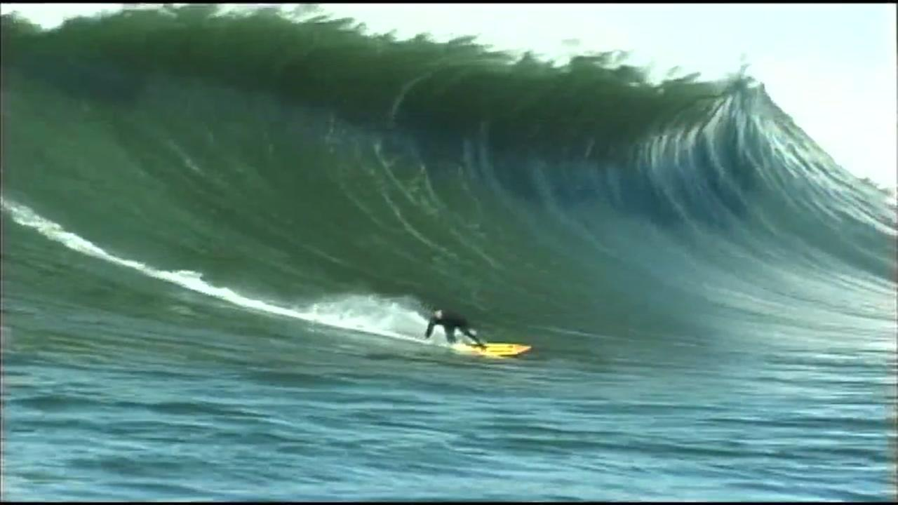 A surfer rides a big wave during the Titans of Mavericks competition in Mavericks, Calif. in this undated photo.
