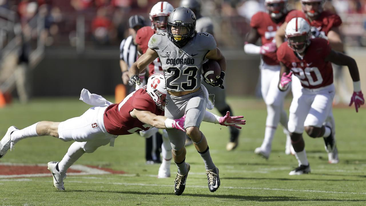 Colorados Nick Fisher (23) rushes against Stanford during the first half of an NCAA college football game, Saturday, Oct. 22, 2016, in Stanford, Calif.