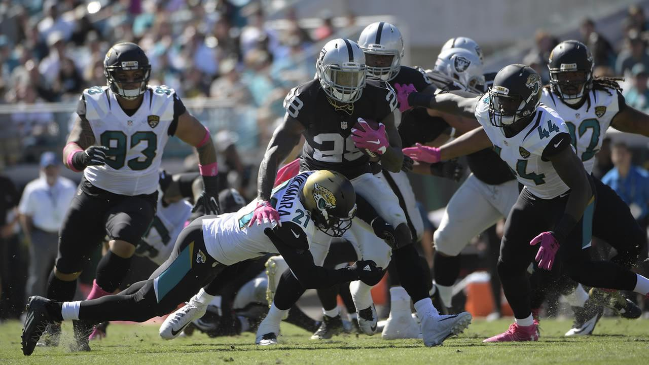 Raiders Latavius Murray runs against Jaguars Prince Amukamara during an NFL football game Sunday, Oct. 23, 2016, in Jacksonville, Fla. (AP Photo/Phelan Ebenhack)