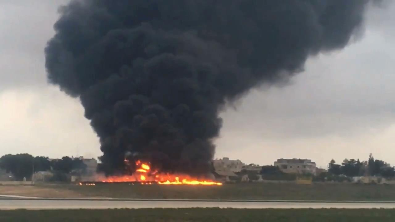 In this image taken from a video smoke billows as a light plane crashed after takeoff from Malta airport, in Valletta, Monday, Oct. 24, 2016.