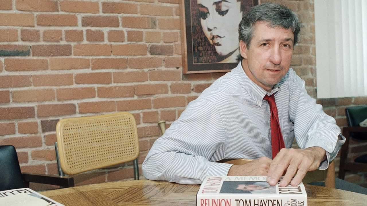In this June 6, 1988 file photo, Tom Hayden talks about his new book, Reunion, during a interview at his office in Santa Monica, Calif.