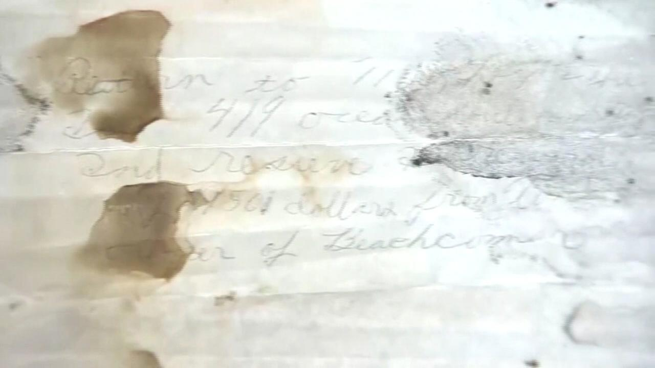 This image shows a note that was found inside a bottle that washed ashore in the Caribbean.