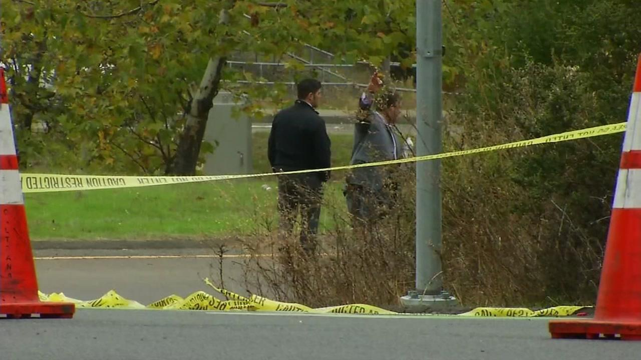 This image shows authorities investigating after a man was gunned down and killed near Hilltop Drive and the on-ramp to eastbound I-80 on Oct. 27, 2016 in Richmond, Calif.