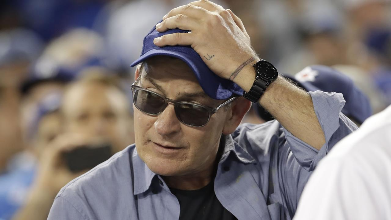 FILE - In this Oct. 19, 2016, file photo, actor Charlie Sheen reacts during the fifth inning of Game 4 of the National League baseball championship.
