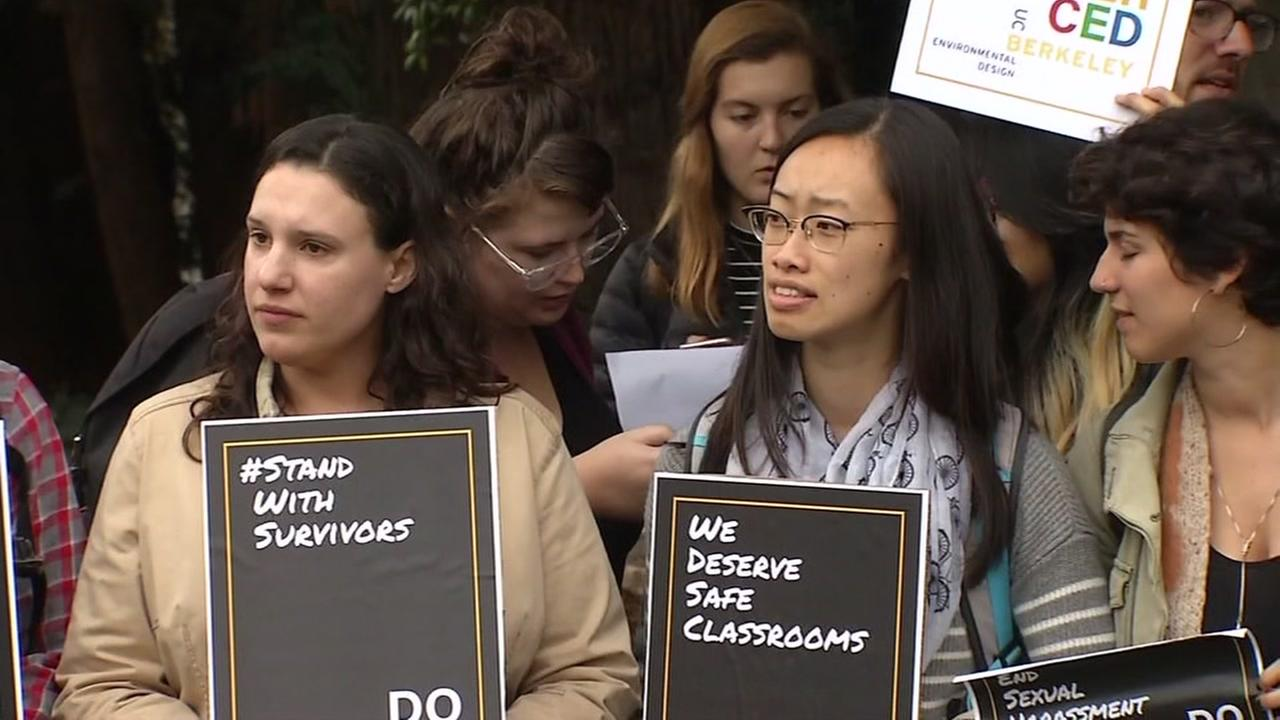 Protesters hold signs on UC Berkeleys campus in Berkeley, Calif.