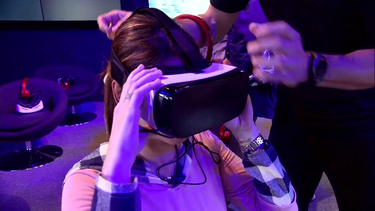 This is an undated image of a woman wearing a virtual reality headset.