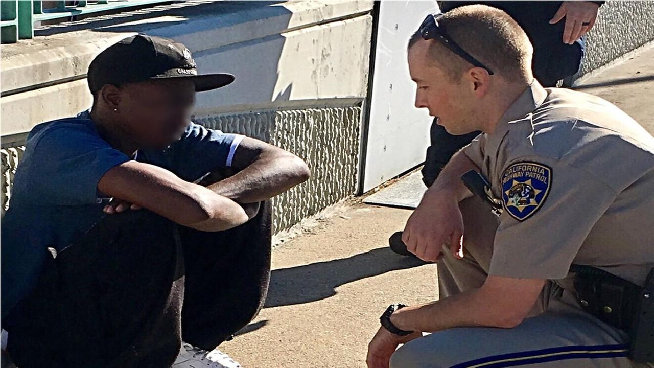 Contra Costa County CHP officer Thomas Westropp-Bennett is pictured with a man he saved from jumping off the Benicia Bridge on Nov. 17, 2016.