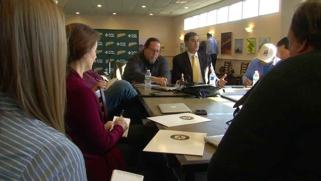 Members of the Oakland Athletics management team meet.