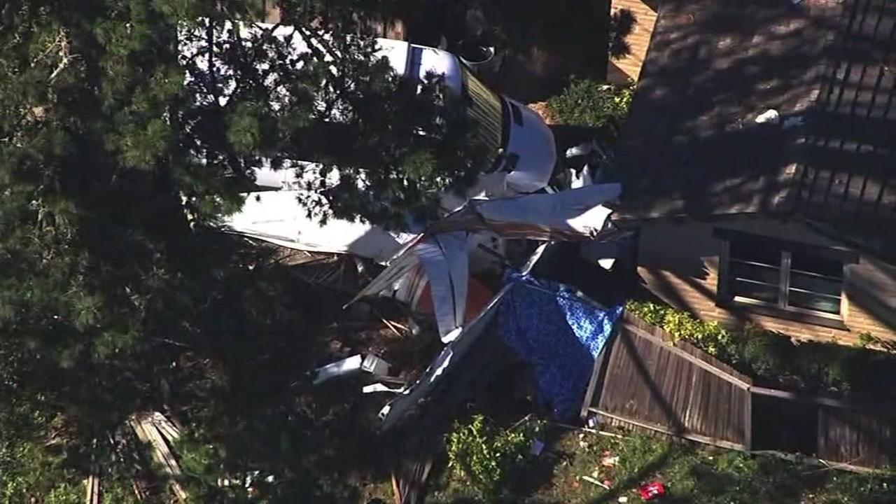 A plane crashed into a home near the Half Moon Bay Airport in Moss Beach, Calif. on Nov. 18, 2016.