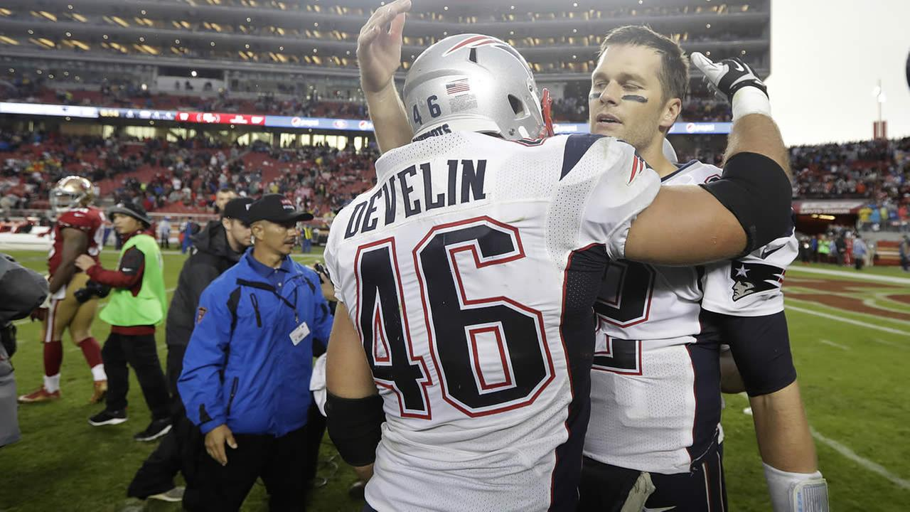 Patriots James Develin and Tom Brady  celebrate after an NFL football game against the San Francisco 49ers in Santa Clara, Calif., Sunday, Nov. 20, 2016. (AP Photo)
