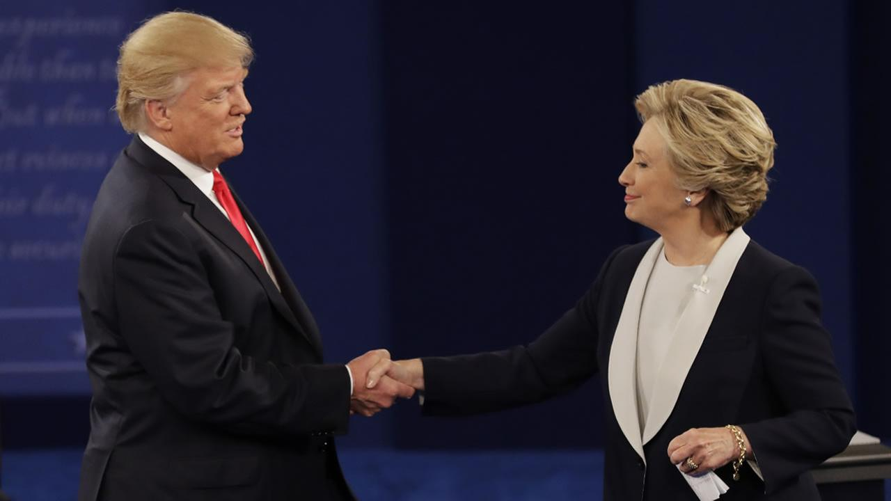 Donald Trump shakes hands with Hillary Clinton following the second presidential debate at Washington University in St. Louis, Sunday, Oct. 9, 2016.