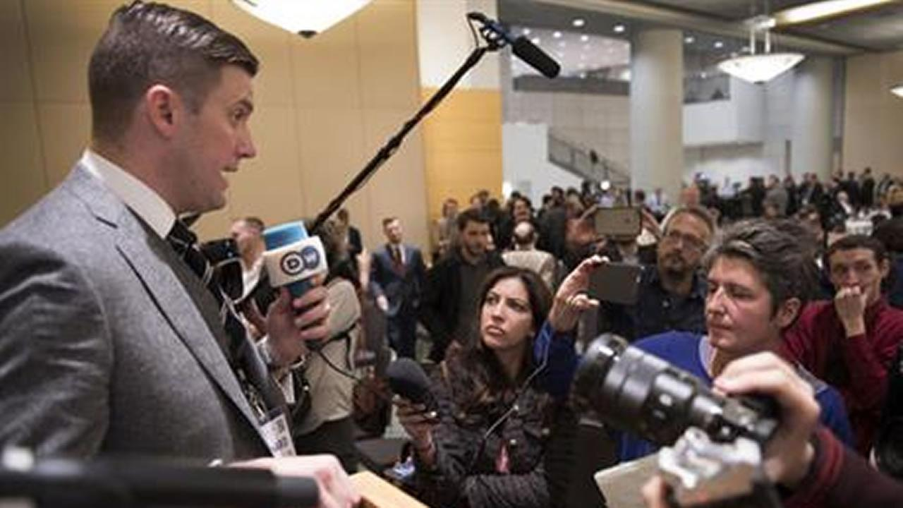 In this Nov. 18, 2016, photo, Richard Spencer, left, talks to the media at an Alt Right conference hosted by the National Policy Institute in Washington.