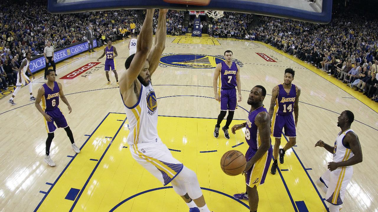 Golden State Warriors JaVale McGee, center, dunks against the Los Angeles Lakers during the first half of an NBA basketball game Wednesday, Nov. 23, 2016, in Oakland, Calif.