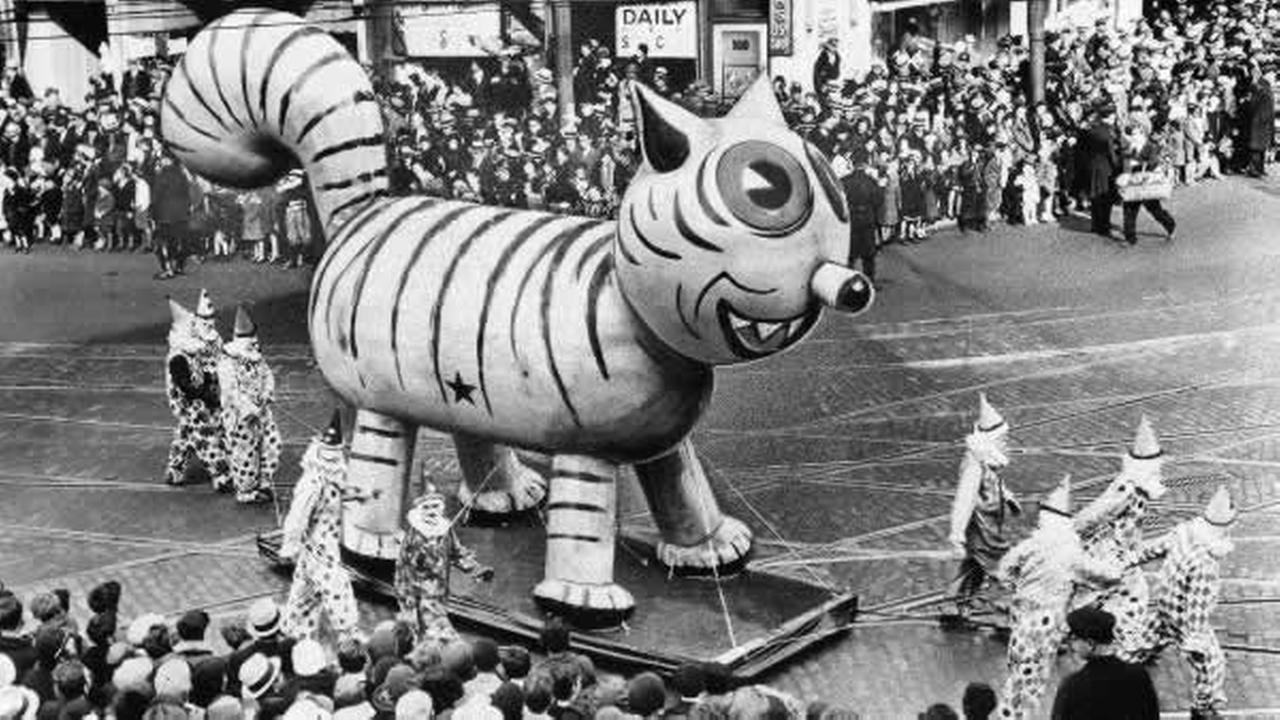 An outdoor float of a big cat makes its way down a street during the Thanksgiving Day Parade in New York City on Nov. 26, 1931.