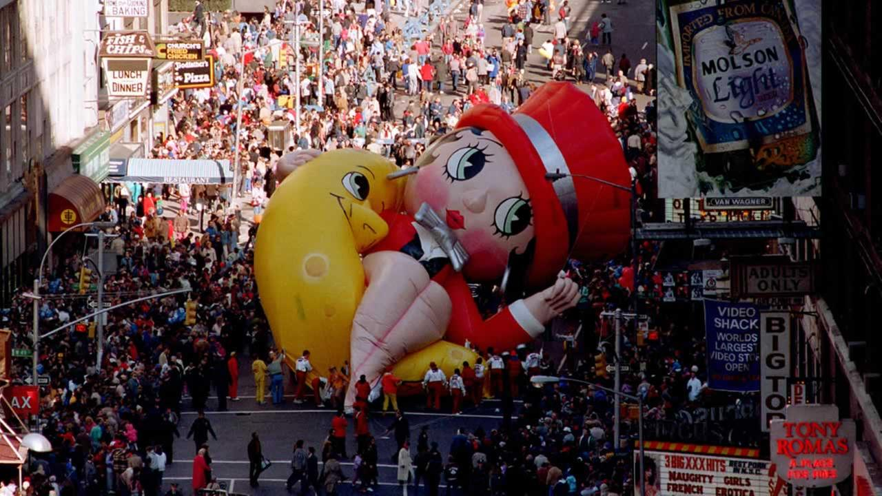 Betty Boop collapses on Broadway near 49th Street as handlers work to raise the deflated helium balloon during the Macys Thanksgiving Day Parade in NYC, Thursday, Nov. 27, 1986.AP Photo/Ron Frehm