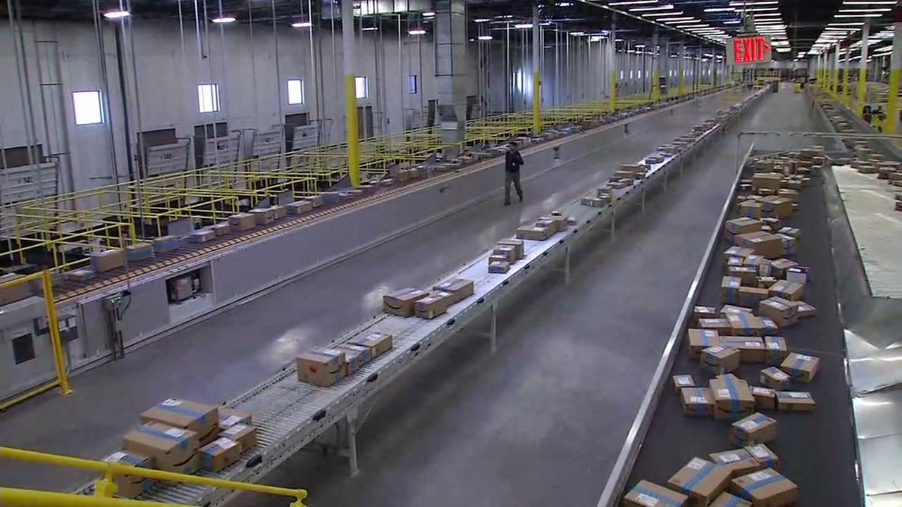 Packages ride down the conveyor belt at the Amazon Fulfillment Center in Tracy, Calif. on Monday, Nov. 28, 2016.