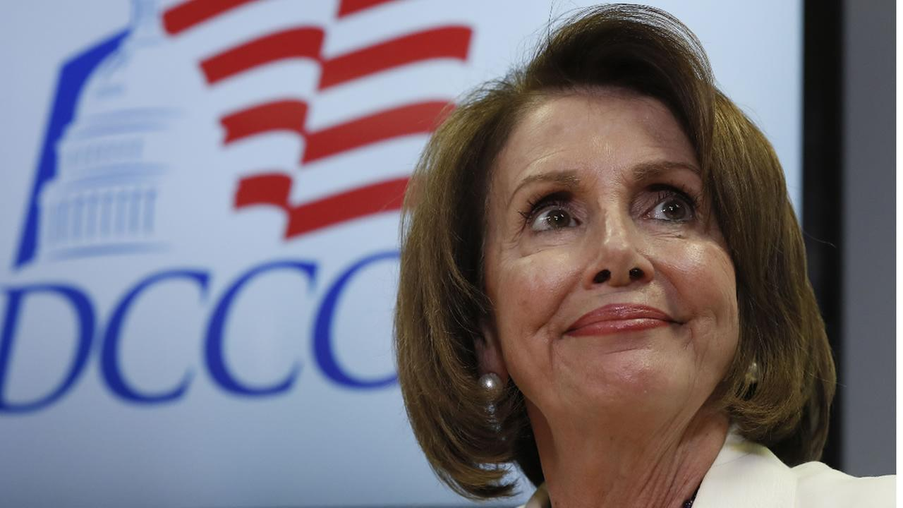 In this Nov. 8, 2016, file photo, House Minority Leader Nancy Pelosi pauses during an election day news conference at the DCCC Headquarters in Washington.