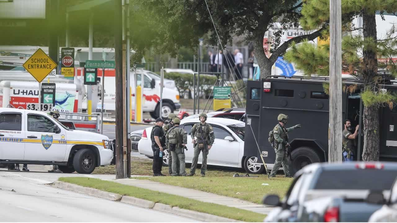 Police negotiators were on the scene of a bank robbery turned hostage situation, Thursday, Dec. 1, 2016, in Jacksonville, Fla.
