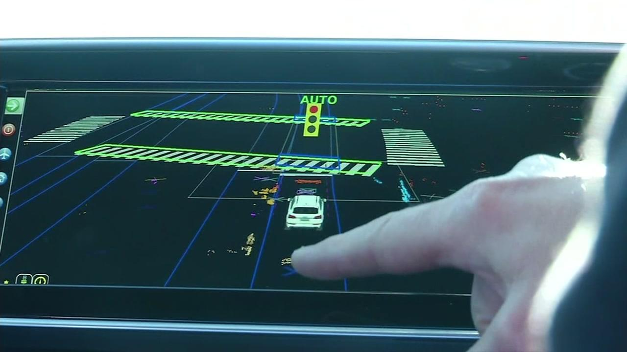 Software for a self-driving car built by Delphi appears on a vehicles screen on Dec. 1, 2016.