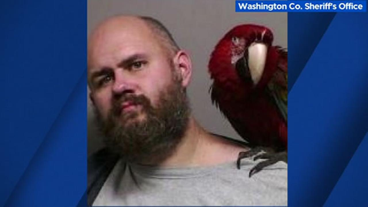 This is a Washington County mugshot of Craig Buckner with his pet bird.