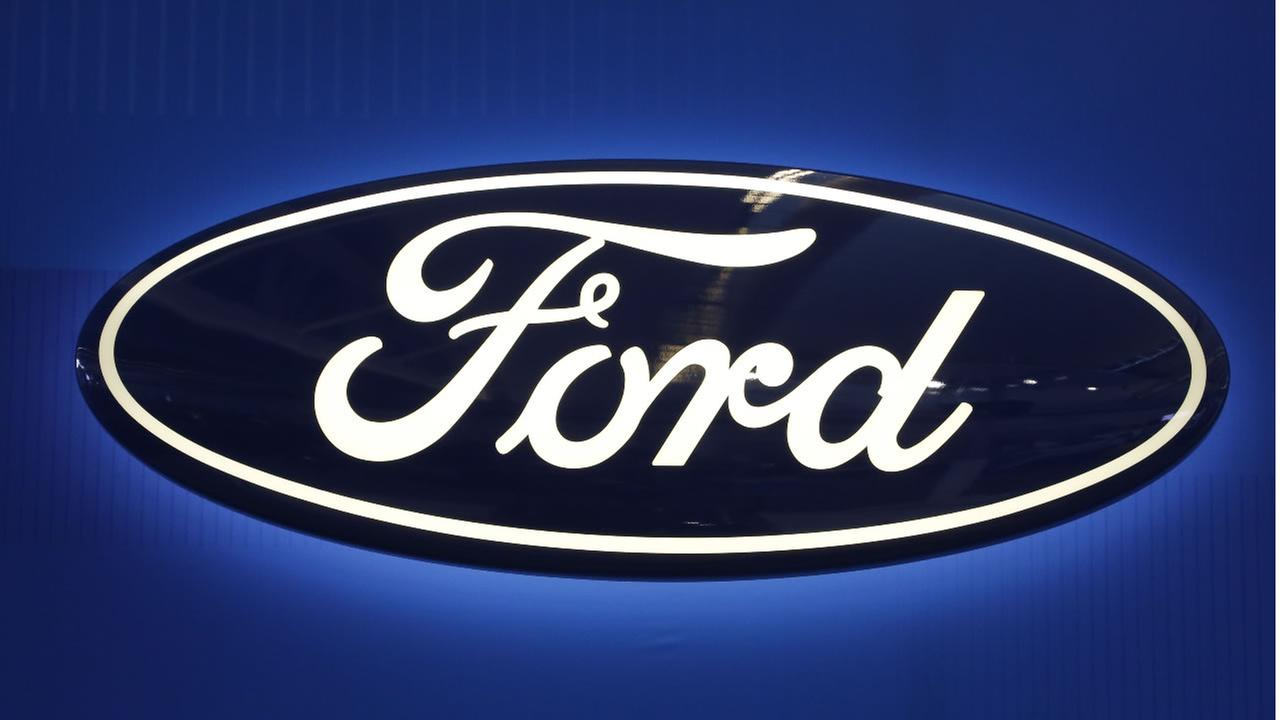 This Feb. 11, 2016, file photo shows the Ford logo on display at the Pittsburgh International Auto Show in Pittsburgh.