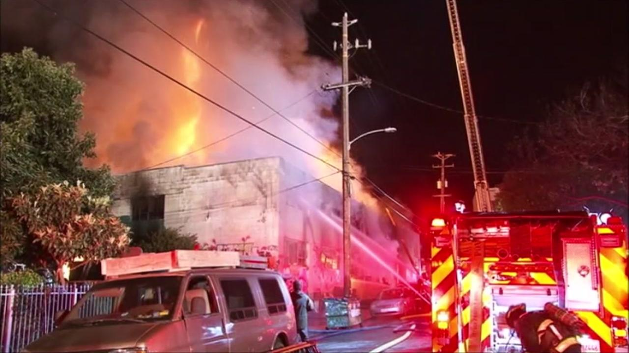 Firefighters battle 3-alarm fire at 31st avenue and International Boulevard.in Oakland, California, Saturday, December 3, 2016.