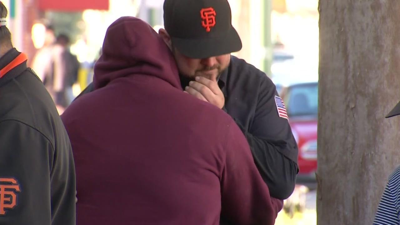 Dan Vega embraces a loved one as he searches for his brother at the Family Assistance Center in Oakland on Dec. 3, 2016.