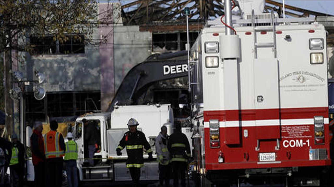 Emergency crew stage at the site of a warehouse fire Tuesday, Dec. 6, 2016, in Oakland, Calif.