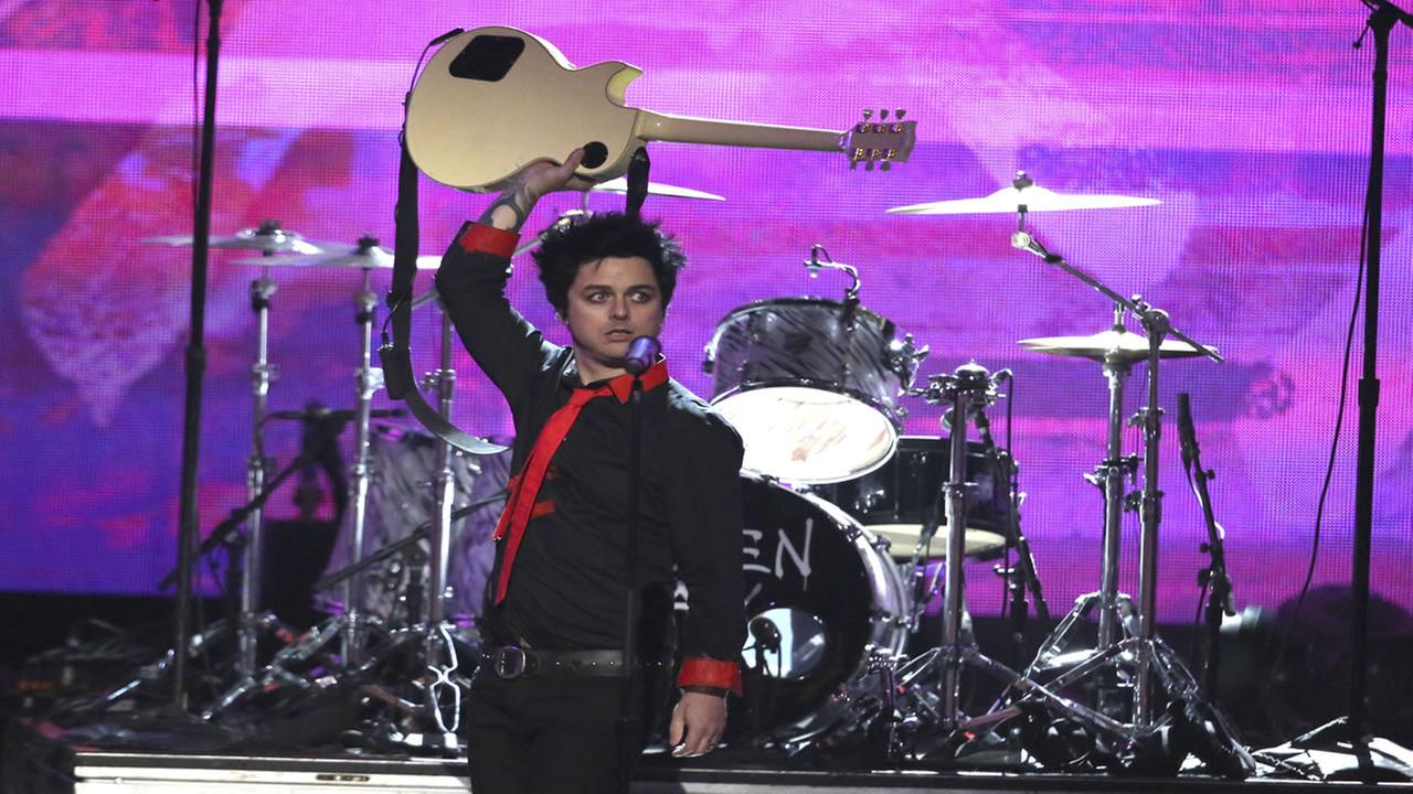 Billie Joe Armstrong, of Green Day, performs Bang Bang at the American Music Awards at the Microsoft Theater on Sunday, Nov. 20, 2016, in Los Angeles.
