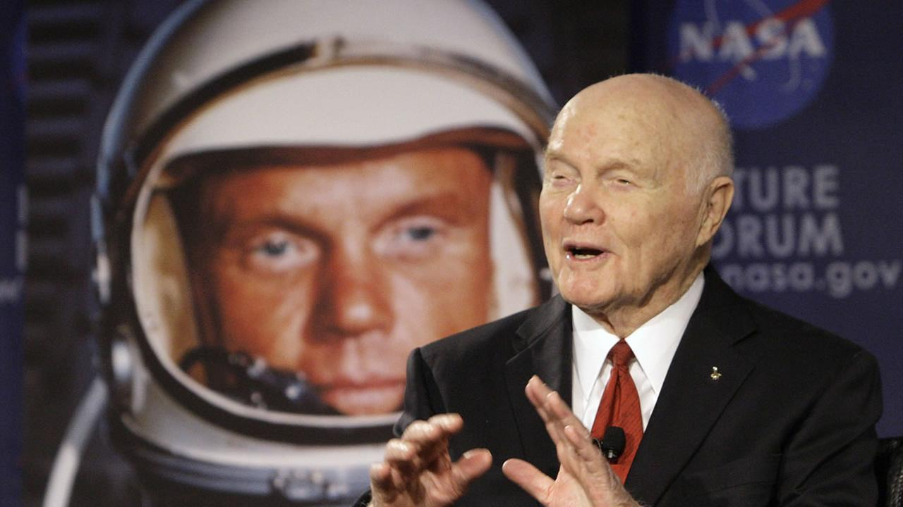 In this Feb. 20, 2012, file photo, U.S. Sen. John Glenn talks with astronauts on the International Space Station via satellite in Columbus, Ohio.