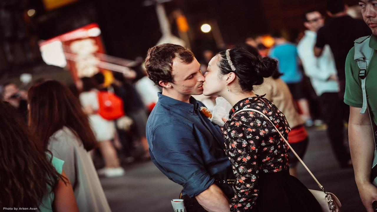 Griffin Madden and Saya Tomioka share a kiss in Times Square in New York on June 5, 2015.
