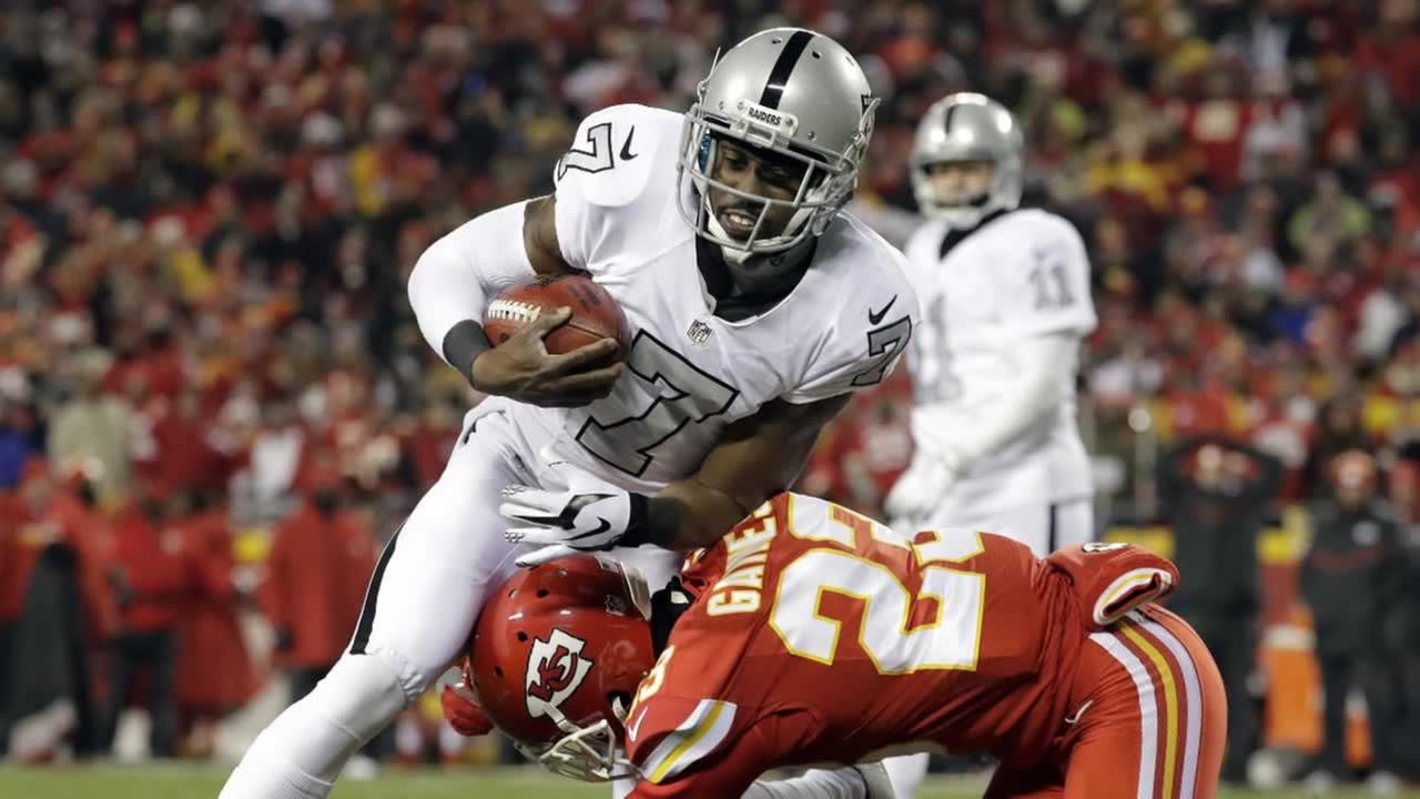 Oakland Raiders punter Marquette King is tackled by Kansas City Chiefs defensive back Phillip Gaines during an NFL football game in Kansas City, Mo., Thursday, Dec. 8, 2016.