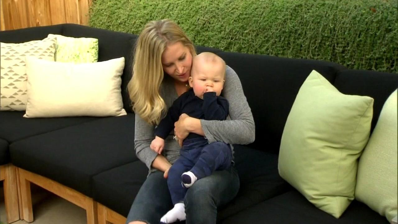 Reality TV star Katy Landrum sits with her son, Bo, while discussing sleep training.