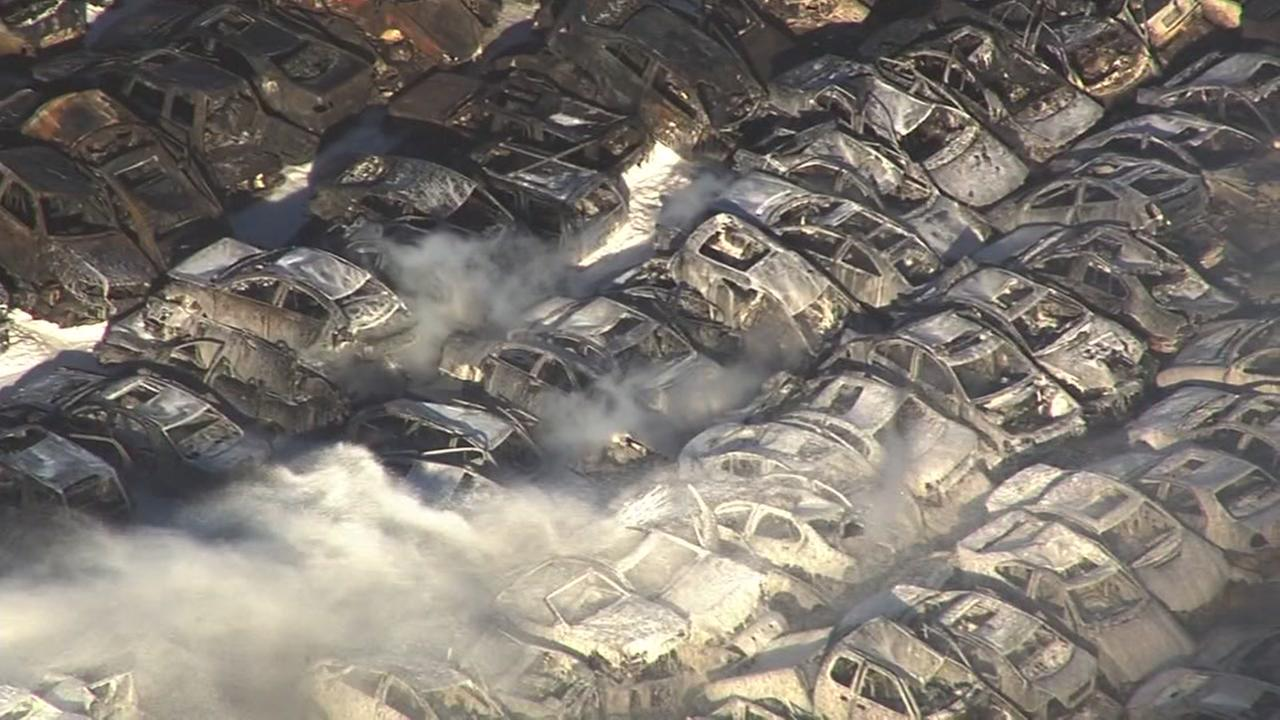 Hundreds of cars were scorched by a fire at an auto wrecking yard in Richmond, Calif. on Friday, Dec. 16, 2016.