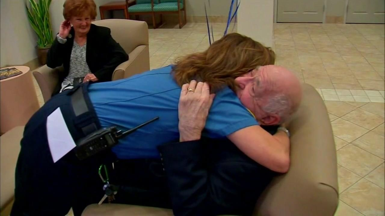 This is an undated image of paramedic Sara Crelin hugging 91-year-old Joseph Leifkin, who suffered a heart attack and was saved by Crelin and two other paramedics in Denville, NJ.