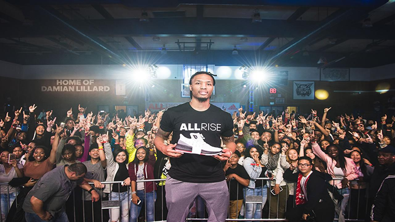 Damian Lillard visits Oakland High School in Oakland, Calif. on Dec. 16, 2016.