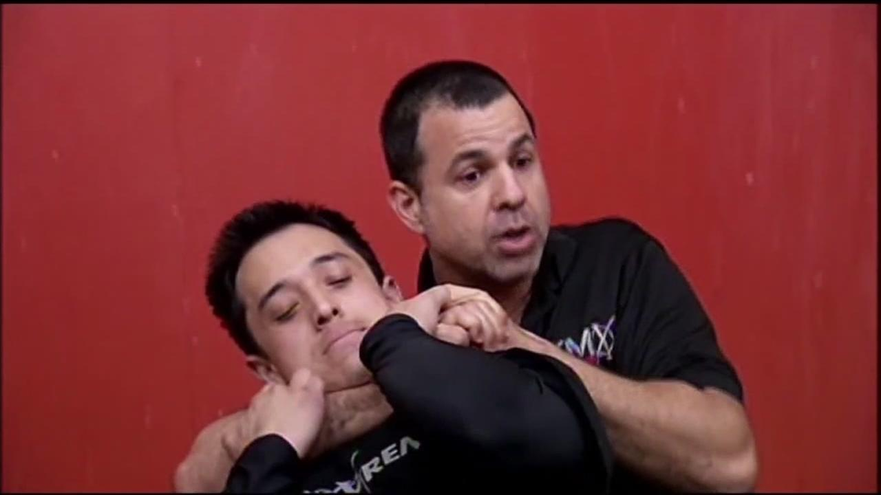 This is an undated image of two men performing a choke hold.