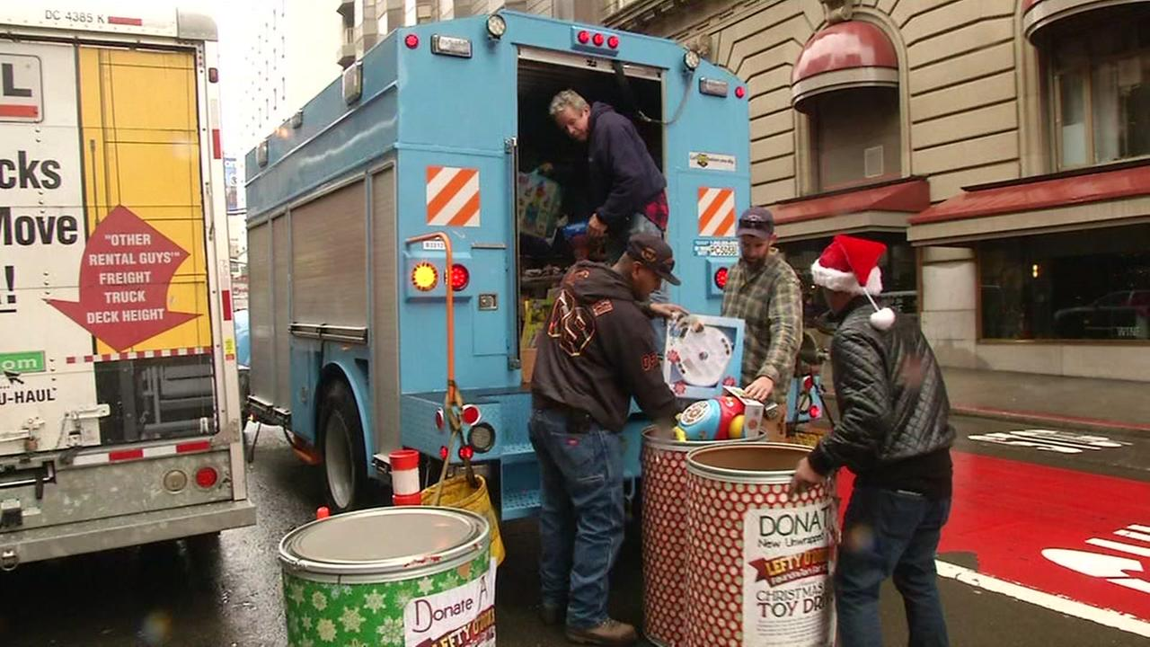 Crews unload toys for kids in front of Lefty ODouls restaurant in San Francisco, Calif. on Friday, December 23, 2016.