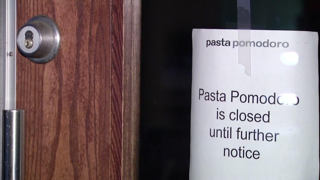 A notice appears on the doors of a Pasta Pomodoro restaurant in San Bruno, Calif. on Dec. 28, 2016.