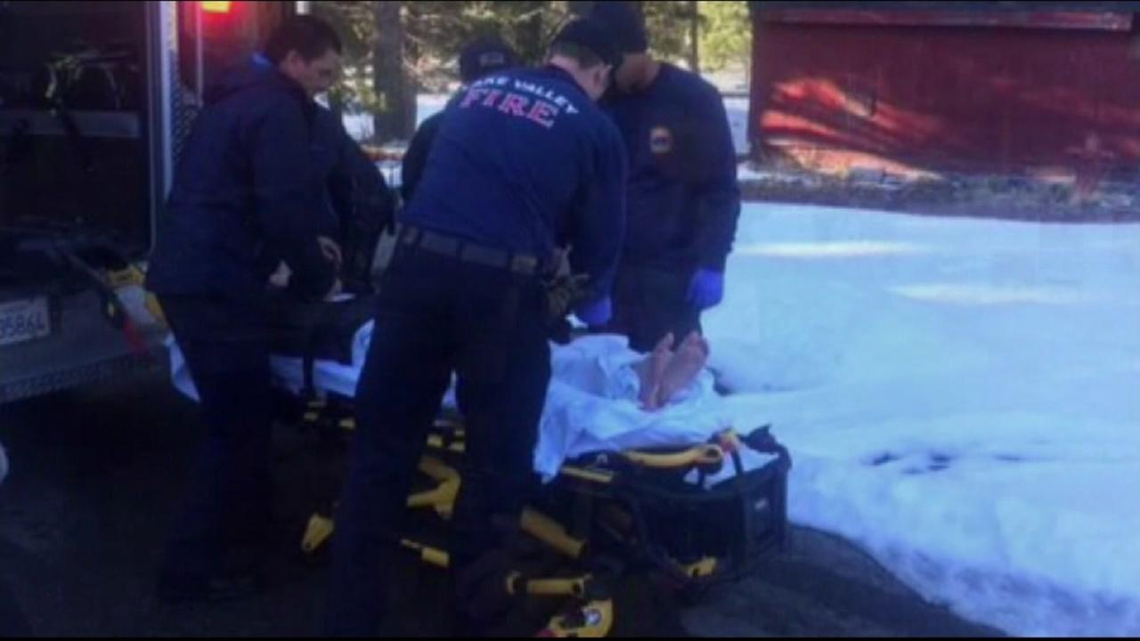 A boy who fell through the ice in Lake Tahoe is tended to by first responders in South Lake Tahoe on Dec. 28, 2016.